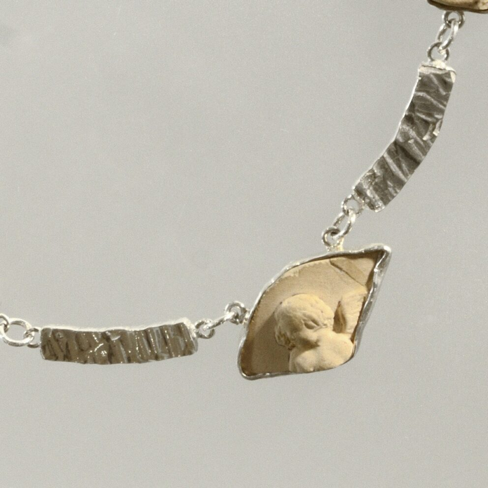 Cherub hammered silver and ostracon necklace